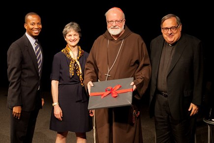 Erik Causey, Elizabeth Meers and Msgr. Peter J. Vaghi present Cardinal O'Malley with a gift at the 2014 Fall Lecture