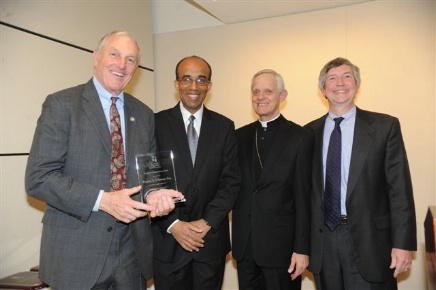 John Carroll Society Members: (Left to Right): Francis T. Coleman; James D. Bishop, Senior Program Manager; His Eminence Donald Cardinal Wuerl; and William E. Lawler III, Immediate Past Chairperson of the Advisory Council.