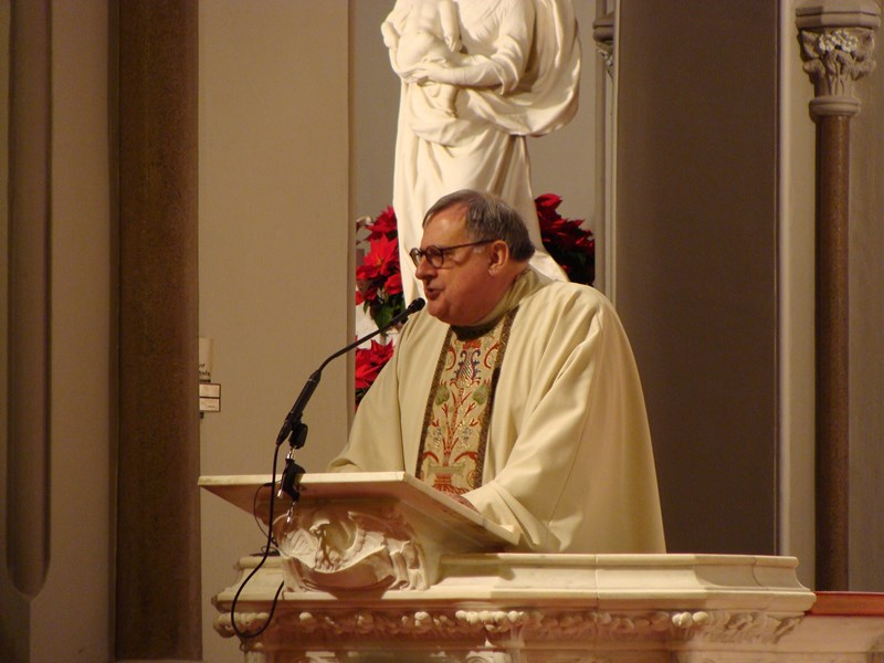 Msgr. Peter J. Vaghi, JCS Chaplain, delivers his homily at the Baptism of the Lord Mass.